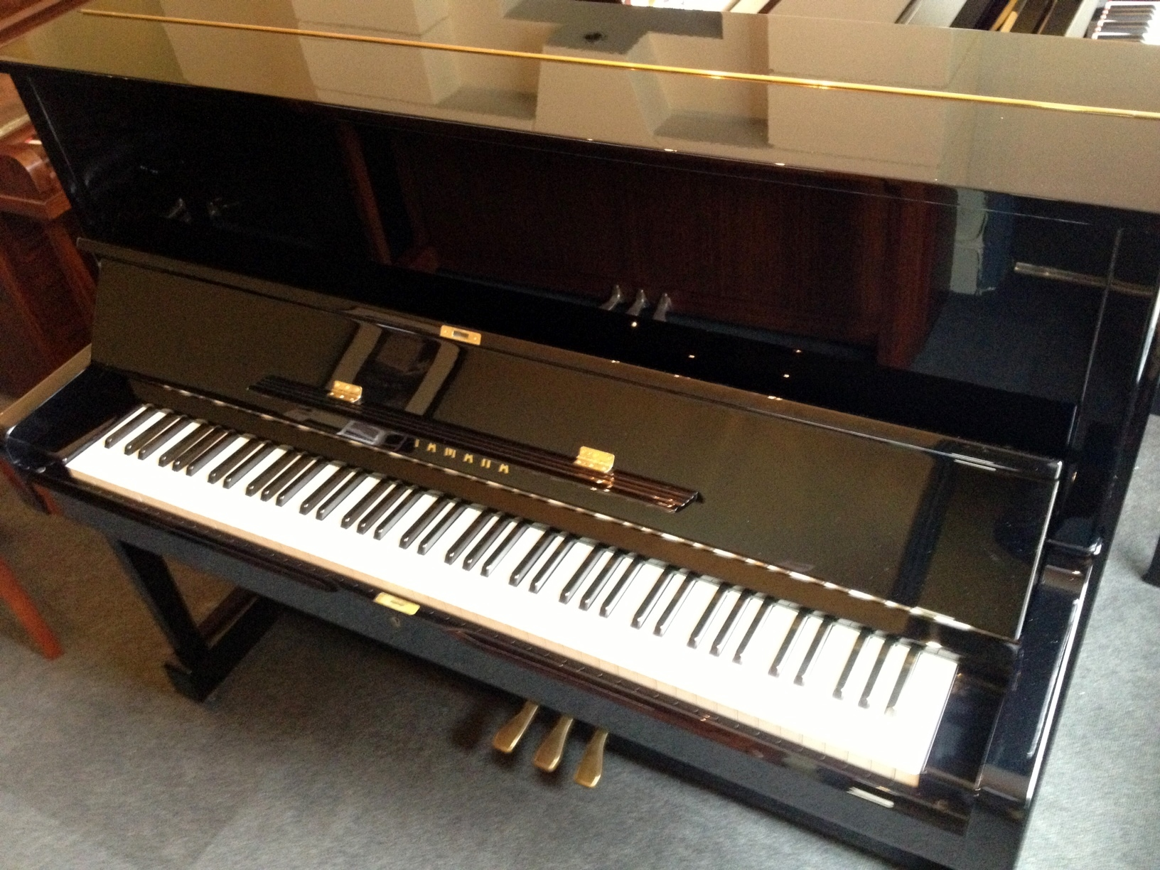 A Yamaha U1 piano in our showroom