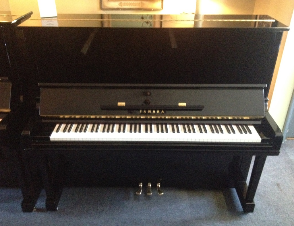 A Yamaha U3 piano in our showroom