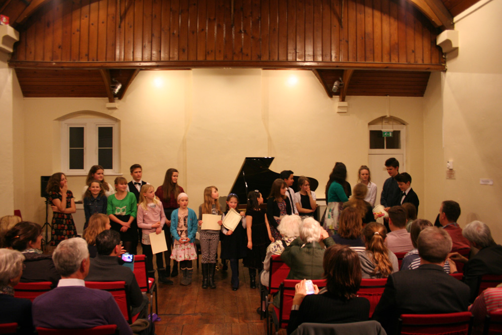Certificates being awarded at the Spring Recital, sponsored by the Piano Shop Bath