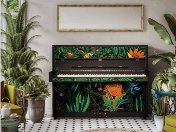A beautiful upright piano sporting a vivid jungle scene using techniques from knitting to embroidery, felting and appliqué
