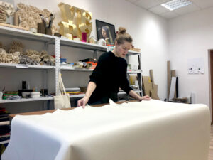 Anka prepares the fabric for production